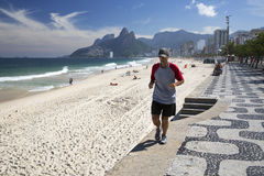 Man runing in Ipanema Beach Rio de Janeriro. In may 11 2015. Ipanema is one of the most famous touristic beaches in Brazil Stock Photos