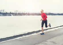 Man runing near winter lake Stock Photos