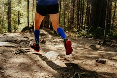 Man runner dynamic. Running in blue compression socks Stock Images