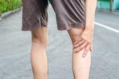Man runner hold her injured leg Royalty Free Stock Images