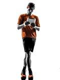 Man runner jogger digital tablets ipad silhouette Royalty Free Stock Image