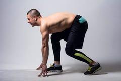 Man runner jogger running isolated. Athlete at the start Stock Photos