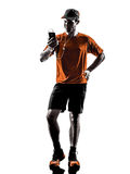Man runner jogger smartphones headphones silhouette Stock Images