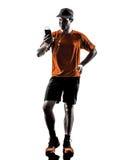 Man runner jogger smartphones headphones silhouette. One young man runner jogger using smartphones headphones in silhouette isolated on white background stock images