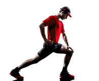 Man runner jogger stretching warming up silhouette Royalty Free Stock Photography
