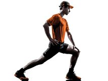 Man runner jogger stretching warming up silhouette Royalty Free Stock Photo