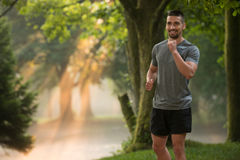 Man Runner Jogging Outdoor Workout In A Park Stock Photo