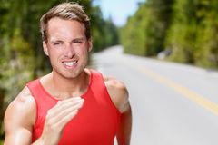 Man runner running endurance training jogging. Man runner running on road training, jogging and exercising for trail run marathon endurance race. Fitness healthy Royalty Free Stock Photography