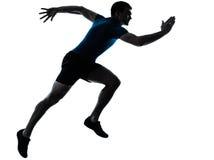 Man runner running sprinter sprinting. One caucasian man runner running sprinter sprinting  in silhouette studio  isolated on white background Stock Photo