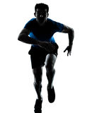 Man runner running sprinter sprinting. One caucasian man runner running sprinter sprinting  in silhouette studio  isolated on white background Royalty Free Stock Images