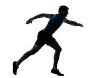 Man runner running sprinter sprinting. One caucasian man runner running sprinter sprinting  in silhouette studio  isolated on white background Royalty Free Stock Photo