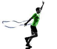 Man runner running winner finish line silhouette. One caucasian man young sprinter runner running winner at finish line in silhouette studio on white background Royalty Free Stock Image
