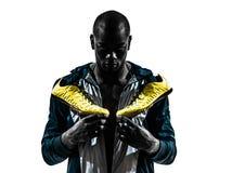 Man runner sprinter jogger posing portrait silhouette. One caucasian man runner sprinter jogger  standing posing  in silhouette studio isolated on white Royalty Free Stock Images