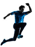 Man runner sprinter jogger shouting silhouette. One caucasian man  running sprinting jogging shouting  in silhouette studio isolated on white background Royalty Free Stock Photography