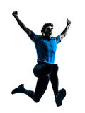 Man runner sprinter jogger shouting silhouette. One caucasian man  running sprinting jogging shouting  in silhouette studio isolated on white background Royalty Free Stock Image