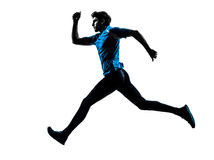 Man runner sprinter jogger silhouette. One caucasian man  running sprinting jogging in silhouette studio isolated on white background Royalty Free Stock Image