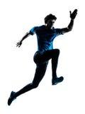 Man runner sprinter jogger silhouette. One  man running sprinting jogging in silhouette studio isolated on white background Stock Image