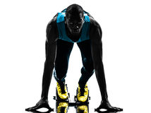 Man runner sprinter on starting blocks   silhouette Stock Photos