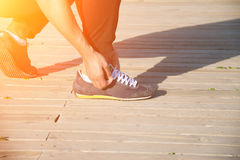 Man runner tying shoelaces. Close up man runner tying shoelaces Stock Images