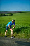 Man runner warming up before jogging Royalty Free Stock Images