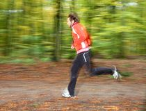 Man running. In forest. Motion blurred Stock Images