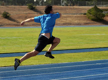 Man running. On a blue racetrack Stock Photo