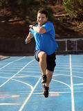 Man running. On a blue racetrack Stock Image