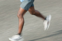 Man running. Close up picture of a man running, motion blur Stock Photography