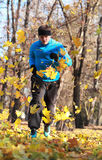 Man running. Image of a man running between falling leaves in a park in autumn Royalty Free Stock Photos