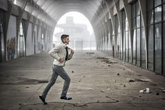 Man Running Through Abandoned Tunnel. Side View of Young Man Running Through Abandoned Arched Tunnel Stock Photos