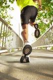 Man running across the bridge Royalty Free Stock Image
