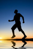 Man running against the evening sky Stock Photography