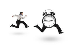 Man running after alarm clock of running legs. Isolated on white background royalty free stock images