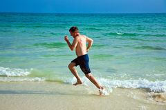 Man is running along the beautiful Stock Photography