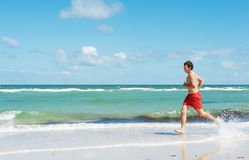 Man running along the coast Royalty Free Stock Images