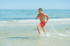 Man running along the coast Royalty Free Stock Photography