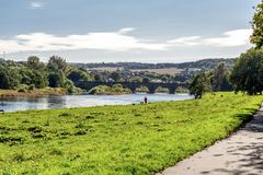 A man running along a shore of river Dee in nice sunny day, Aberdeen royalty free stock images