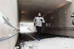 Man running along subway tunnel in winter Stock Image