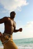 Man Running On The Beach Stock Image