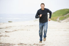 Man running at beach. Smiling Royalty Free Stock Photos