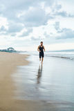 Man Running On Beach, Jogging During Outdoor Workout. Sports Con Royalty Free Stock Image