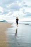 Man Running On Beach, Jogging During Outdoor Workout. Sports Con Stock Image