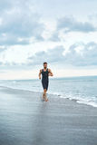 Man Running On Beach, Jogging During Outdoor Workout. Sports Con Royalty Free Stock Images