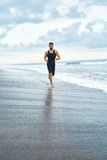 Man Running On Beach, Jogging During Outdoor Workout. Sports Con Stock Photography