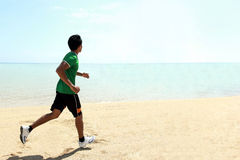 Man running on the beach Royalty Free Stock Images