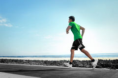 Man running on the beach Stock Photography