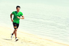 Man running on the beach Royalty Free Stock Image