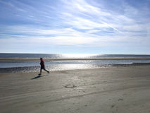 Man running on the beach Royalty Free Stock Photos