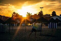 Man Running in the Beach during Sunset stock images