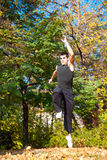 Man running in a beautiful autumn park Royalty Free Stock Images